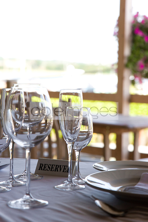 Close up of tableware and reserved sign on a restaurant table