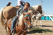 Native American, girl, Shetland Pony, Crow Fair, Indian Rodeo, Montana.