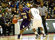 Carl Blair (14) of Prairie View A&M drives to the basket against Keeslee Howard (11) of Jackson State during the SWAC semi-finals at the Curtis Culwell Center in Garland on Friday, March 15, 2013. (Cooper Neill/The Dallas Morning News)