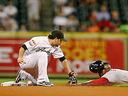 Aug 9, 2012; Houston, TX; USA; Washington Nationals left fielder Roger Bernadina (2) steals second base as Houston Astros second baseman Jose Altuve (27) drops the ball during the fourth inning at Minute Maid Park. Mandatory Credit: Thomas Campbell-US PRESSWIRE
