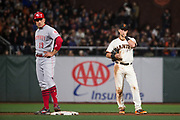 San Francisco Giants second baseman Joe Panik (12) reacts to Cincinnati Reds first baseman Joey Votto (19) being on base at AT&T Park in San Francisco, California, on May 11, 2017. (Stan Olszewski/Special to S.F. Examiner)