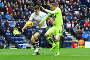 Preston North End Striker Jordan Hugill and Huddersfield Midfielder Philip Billing during the Sky Bet Championship match between Preston North End and Huddersfield Town at Deepdale, Preston, England on 6 February 2016. Photo by Pete Burns.