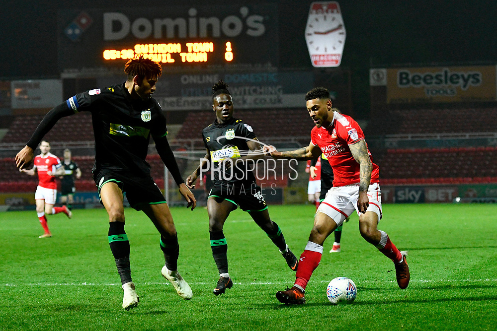 Kaiyne Woolery (22) of Swindon Town on the attack during the EFL Sky Bet League 2 match between Swindon Town and Yeovil Town at the County Ground, Swindon, England on 10 April 2018. Picture by Graham Hunt.