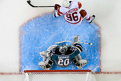 April 29, 2010; San Jose, CA, USA;  San Jose Sharks goalie Evgeni Nabokov (20) blocks a shot from Detroit Red Wings left wing Tomas Holmstrom (96) during the first period in game one of the western conference semifinals of the 2010 Stanley Cup Playoffs at HP Pavilion.  San Jose defeated Detroit 4-3. Mandatory Credit: Jason O. Watson / US PRESSWIRE