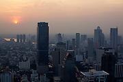 Downtown Bangkok and Chao Phraya River at sunset seen from Banyan Tree Hotel's Vertigo Grill & Moon Bar on the 61st floor.