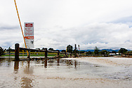 September 13, 2013: A small creek in on Alkire Street in Arvada, CO overflows its banks and crosses the entry way to the parking lot of the Youth Memorial Sports Complex after record breaking rains hit Colorado over the last few days