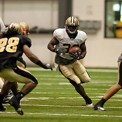 08 August 2009: New Orleans Saints running back Lynell Hamilton (30) runs through a hold during the New Orleans Saints annual training camp Black and Gold scrimmage held at the team's indoor practice facility in Metairie, Louisiana.