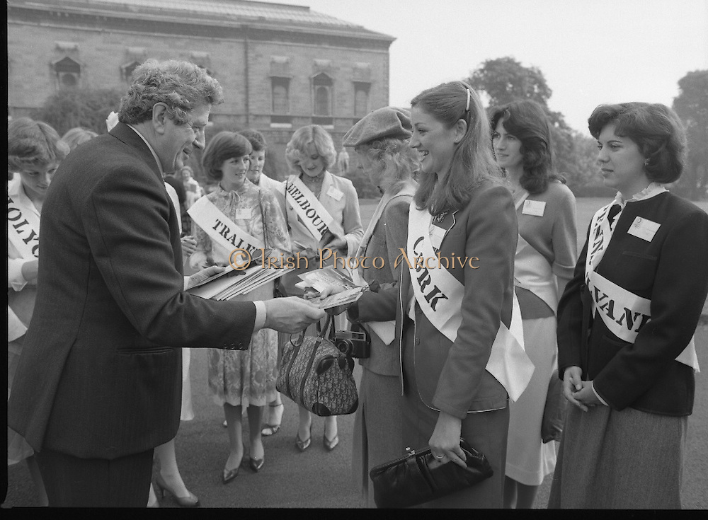 An Taoiseach Meets The Roses Of Tralee.  (N90)..1981..28.08.1981..08.28.1981..28th August 1981..An Taoiseach, Garret Fitzgerald, met with the contestants of The Rose Of Tralee Festival when they were invited to Government Buildings, Leinster House, Dublin...An Taoiseach, Garret Fitzgerald, is pictured presenting Cork Rose, Nuala O'Sullivan, with her rose and and booklet in the garden of Government Buildings.