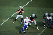 Oakland Raiders quarterback Derek Carr (4) looks for an open receiver against the Buffalo Bills in the first quarter at Oakland Coliseum in Oakland, Calif., on December 4, 2016. (Stan Olszewski/Special to S.F. Examiner)