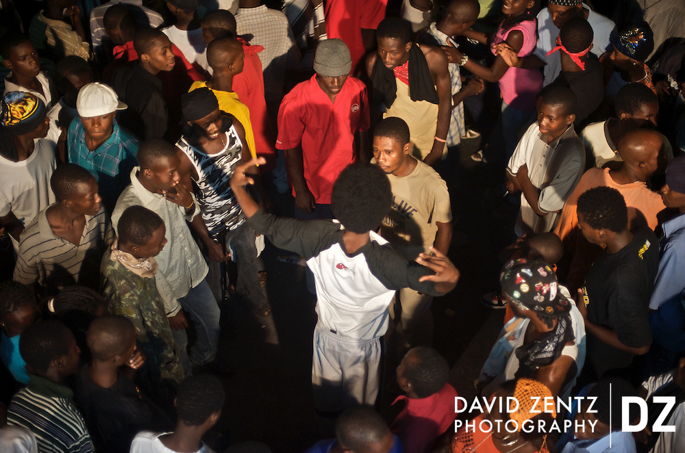 Young men battle, a hip-hop tradition where individuals try to one-up each other with their dance moves, duing a ti sourit, an all-night block party in Port-au-Prince, Haiti on July 13, 2008. The parties feature a heavy dose of Rap Kreyol and are popular with young hip-hop enthusiasts.