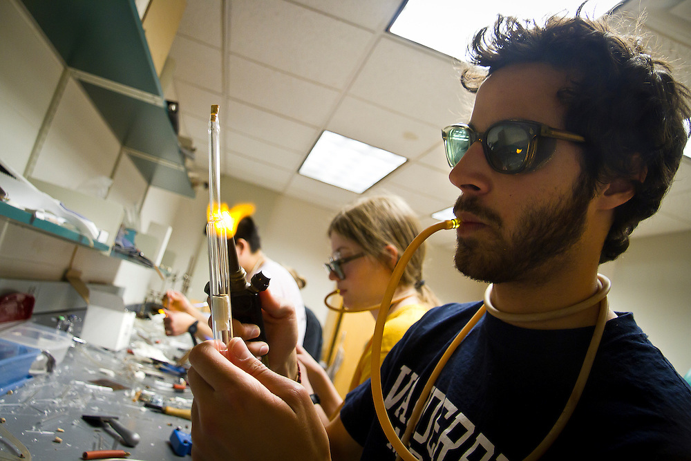 Shyam Deshpande '11 focuses intently on creating a ring seal on his midsemester project for the Scientific Glassblowing independent study in the Glass Lab of Noyce Science Center on Tuesday.