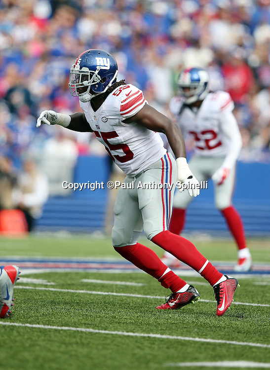 New York Giants middle linebacker Jon Beason (52) chases the action during the 2015 NFL week 4 regular season football game against the Buffalo Bills on Sunday, Oct. 4, 2015 in Orchard Park, N.Y. The Giants won the game 24-10. (©Paul Anthony Spinelli)