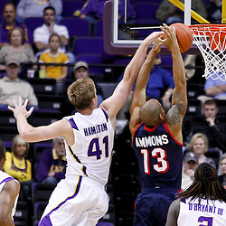 November 23, 2011; Baton Rouge, LA; LSU Tigers center Justin Hamilton (41) blocks a shot by South Alabama Jaguars forward Mychal Ammons (13) during the first half of a game at the Pete Maravich Assembly Center.  Mandatory Credit: Derick E. Hingle-US PRESSWIRE