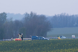 © Licensed to London News Pictures. 29/03/2014. CITY/TOWN e.g Windsor, UK A light aircraft has crashed in a field in Essex, killing the pilot and a passenger. Emergency services rushed to the scene after reports a plane had gone down in a field near the A414 outside Chelmsford in Essex.Essex Police said the Yak 52 aircraft's pilot and passenger, both men from Essex, were killed after the plane flew out from North Weald airfield.  Photo credit : Simon Ford/LNP