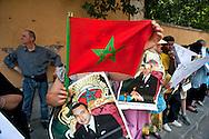 Roma 25 Giugno 2012.Manifestazione della Comunità marocchina in Italia davanti all'Ambasciata del Marocco, per protestare contro il trasferimento del consolato a Napoli e per chiedere le dimissioni dell'ambasciatore. I manifestanti con le foto del Re Mohammed VI.Demostration of the Moroccan Community in Italy in front of the Embassy of Morocco, to protest against the transfer of the consulate in Naples and to demand the resignation of  the Ambassador.Demonstrators with pictures of King Mohammed VI