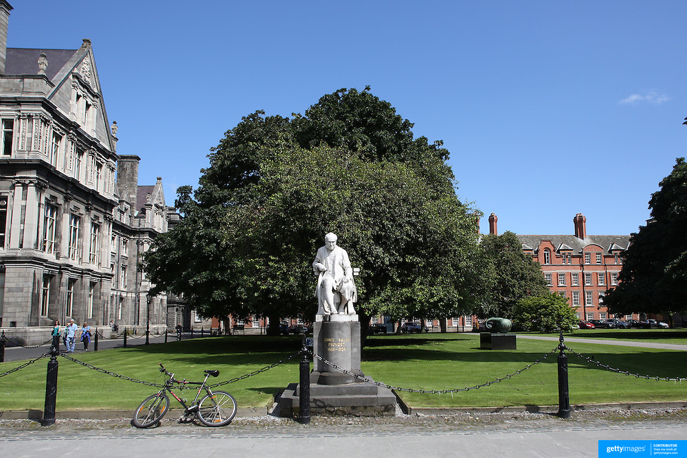 A sculpture by John Hughes, showing Provost of Trinity College, George Salmon. The statue is located next to the campanile in the courtyard of  Trinity College, Dublin. (Irish: Coláiste na Tríonóide). Formally known as the College of the Holy and Undivided Trinity of Queen Elizabeth near Dublin, is the sole constituent college of the University of Dublin in Ireland. The college was founded in 1592. It is one of the seven ancient universities of Britain and Ireland, as well as Ireland's oldest university. Dublin, Ireland. Photo Tim Clayton