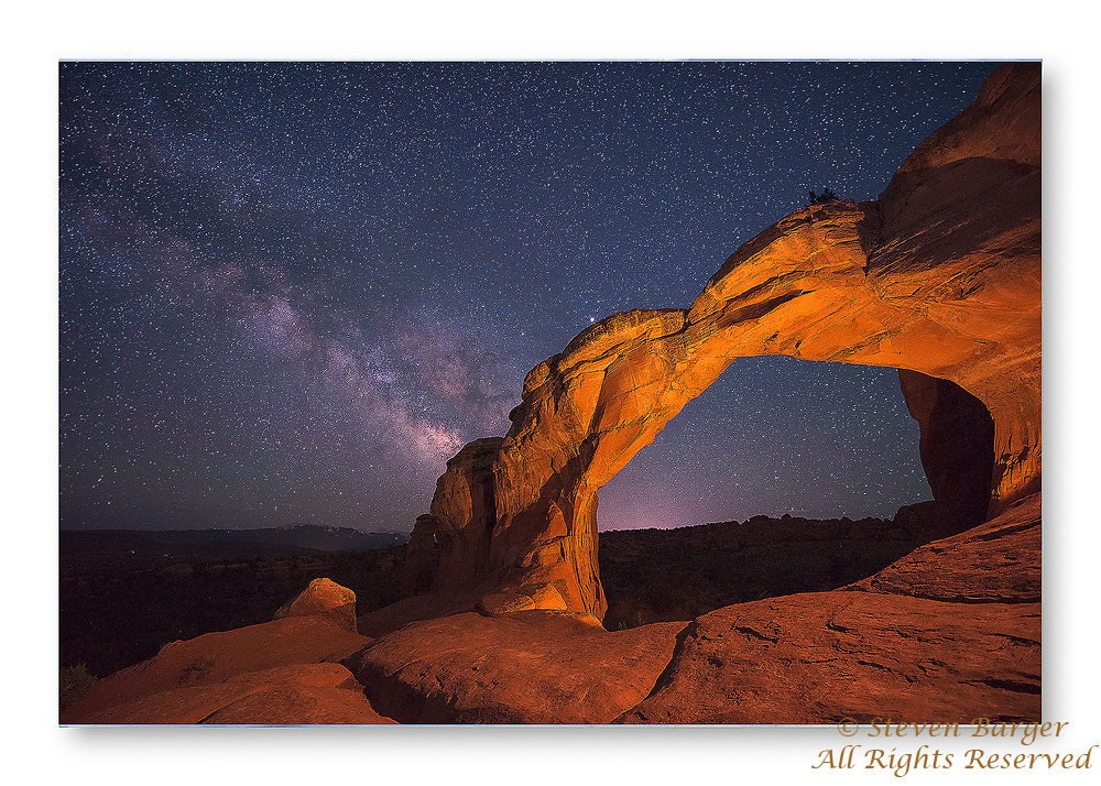 Double Arch in Arches National Park near Moab Utah photographed at night using light painting to illuminate Double Arch.