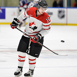 WHITBY, - Dec 18, 2015 -  Game #12 - Bronze Medal Game, Team Canada East vs. United States at the 2015 World Junior A Challenge at the Iroquois Park Recreation Complex, ON. Makail Parker #16 of Team Canada East works the puck during the pre-game warm-up.<br /> (Photo: Shawn Muir / OJHL Images)