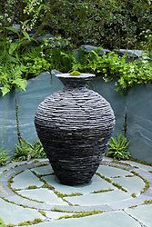 Slate urn sculpture as focal point. Slate paving engraved with words. The Cumbrian Fellside Garden. Design: Kim Wilde and Richard Lucas - Chelsea 2005
