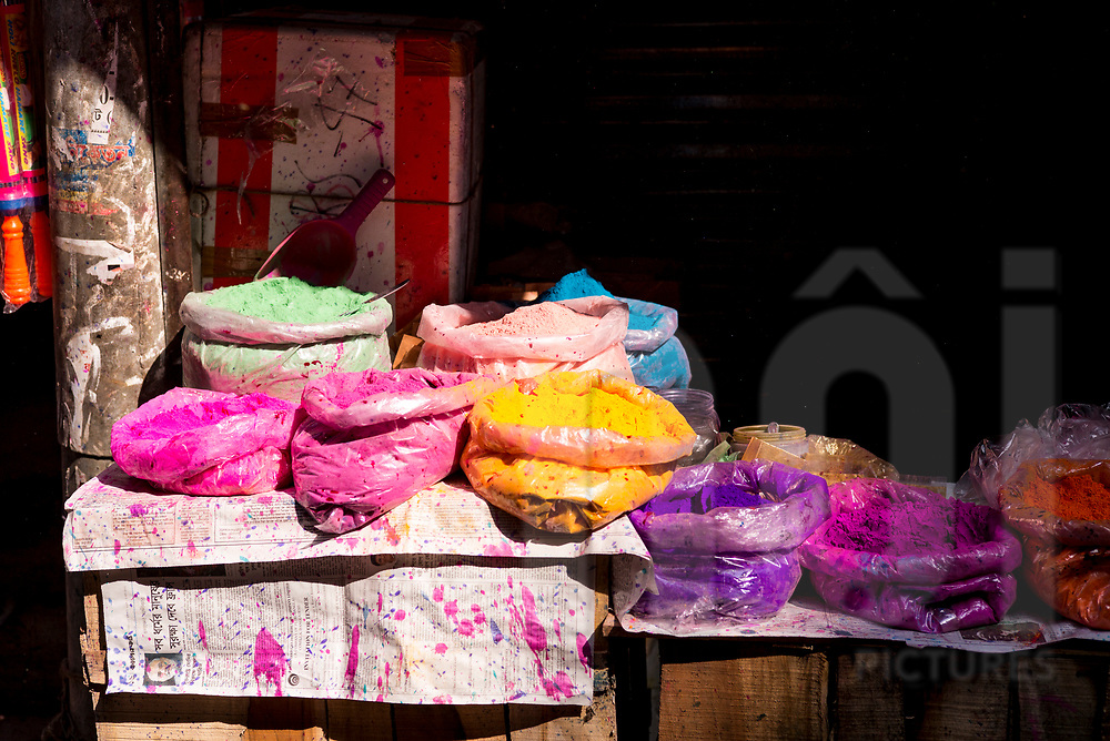 Colorful powder sold for Holi festival in a shop of Shakhari Bazar, Dhaka, Bangladesh, Asia