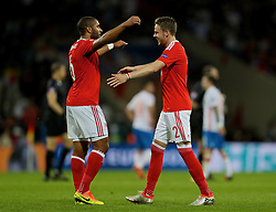 TOULOUSE, FRANCE - Monday, June 20, 2016: Wales captain Ashley Williams and Chris Gunter celebrate their 3-0 victory over Russia and qualification for the knock-out stage during the final Group B UEFA Euro 2016 Championship match at Stadium de Toulouse. (Pic by David Rawcliffe/Propaganda)
