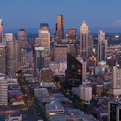 An overview of the Seattle skyline and Mt Rainier in the evening.
