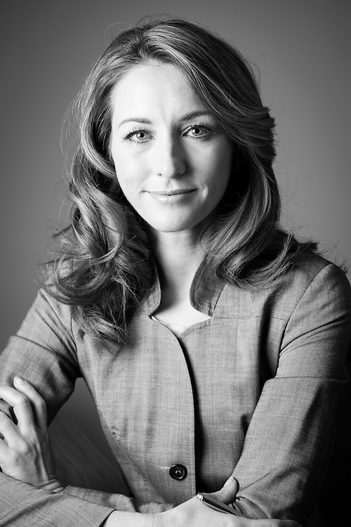 Headshot portrait of an attractive and smart mature caucasian businesswoman. Black and white. Looking to camera.