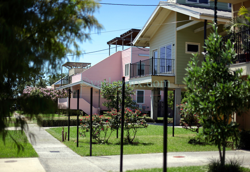 26 August 2015. New Orleans, Louisiana. <br /> Hurricane Katrina revisited. <br /> Rebuilding the Lower 9th Ward. <br /> 'Make it Right' houses on Tennessee Street. Eco friendly 'Make it Right' houses inspired by actor Brad Pitt continue to provide hope for the rebirth of the community following the devastation of hurricane Katrina a decade earlier.<br /> Photo credit&copy;; Charlie Varley/varleypix.com.
