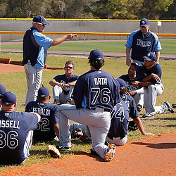 February 20, 2011; Port Charlotte, FL, USA; Tampa Bay Rays manager Joe Maddon talks to pitchers and catchers following a spring training practice at Charlotte Sports Park.  Mandatory Credit: Derick E. Hingle