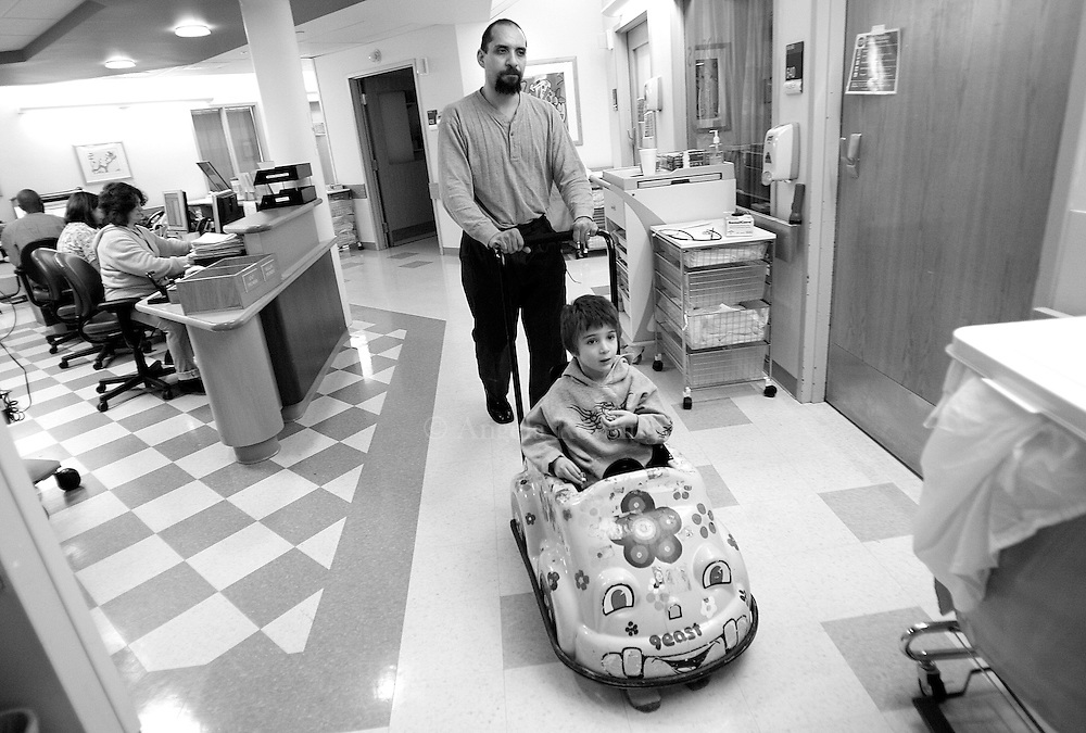 Aidan Sumner, 4, gets a ride from his dad, Joseph, through the hallways of Boston Children's Hospital,  February 25, 2008.  Aidan spent the night in the hospital after having a bad reaction to some medication he was taking to treat his lead poisoning.