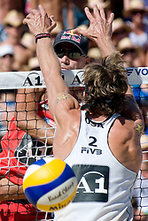 Phil Dalhausser of USA strikes by block of Matt Fuerbringer of USA at A1 Beach Volleyball Grand Slam tournament of Swatch FIVB World Tour 2010, final, on August 1, 2010 in Klagenfurt, Austria. (Photo by Matic Klansek Velej / Sportida)