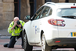 © Licensed to London News Pictures. 08/09/2019. Manchester, UK. A white Renault Megane minicab is examined at the scene . Police seal off several blocks in the Northern Quarter of Manchester City Centre and carry out extensive fingertip and forensic searches after an Audi A3 was driven at crowds during a fight , centred around Dale Street and Newton Street , in the early hours of the morning (Sunday 8th September 2019). It's understood a fight started at the Twenty Twenty Two Club before spilling out on to the streets at about 3:30AM . Photo credit: Joel Goodman/LNP