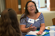 Yumi Choe fills talks with with her mentee during the Women's Mentoring Meet and Greet event on Sept. 4, 2018 in Walter Rotunda. Photo by Hannah Ruhoff