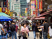 14 JUNE 2018 - SEOUL, SOUTH KOREA: A shopping street in Namdaemun Market. Namdaemun Market is one of the oldest continually running markets in South Korea, and one of the largest retail markets in Seoul. The streets in which the market is located were built in a time when cars were not prevalent, so the market itself is not accessible by car. The main methods of transporting goods into and out of the market are by motorcycle and hand-drawn carts. It occupies many city blocks, which are blocked off from most car traffic due to the prevalence of parking congestion in the area.     PHOTO BY JACK KURTZ