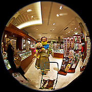 Manhattan - Fisheye Images - 'funny man' wandering around in Macys with his dog