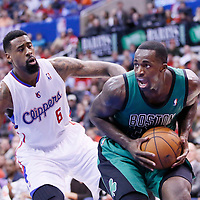 08 January 2014: Boston Celtics power forward Brandon Bass (30) drives past Los Angeles Clippers center DeAndre Jordan (6) during the Los Angeles Clippers 111-105 victory over the Boston Celtics at the Staples Center, Los Angeles, California, USA.