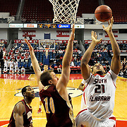 South Alabama's forward Augustine Rubit (21) shoots over Denver's forward, Rob Lewis (10), in the second half of play in Mobile, AL. Denver defeated South Alabama 67-50 on January 7, 2012.