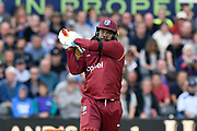 Chris Gayle of of West Indies hits the ball over the boundary for six runs during the One Day International match between England and West Indies at the Brightside County Ground, Bristol, United Kingdom on 24 September 2017. Photo by Graham Hunt.