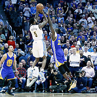 13 February 2017: Denver Nuggets guard Will Barton (5) takes a jump shot over Golden State Warriors forward Draymond Green (23) during the Denver Nuggets 132-110 victory over the Golden State Warriors, at the Pepsi Center, Denver, Colorado, USA.
