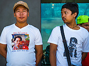 23 JUNE 2016 - MAHACHAI, SAMUT SAKHON, THAILAND:  Burmese men wait for Aung San Suu Kyi to arrive in Samut Sakhon, a province south of Bangkok. Tens of thousands of Burmese migrant workers, most employed in the Thai fishing industry, live in Samut Sakhon. Aung San Suu Kyi, the Foreign Minister and State Counsellor for the government of Myanmar (a role similar to that of Prime Minister or a head of government), is on a state visit to Thailand. Even though she and her party won the 2015 elections by a landslide, she is constitutionally prohibited from becoming the President due to a clause in the constitution as her late husband and children are foreign citizens       PHOTO BY JACK KURTZ