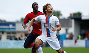 Reise Allassani watching the loose ball during the Pre-Season Friendly match between Hampton & Richmond and Crystal Palace at Beveree Stadium, Richmond Upon Thames, United Kingdom on 27 July 2015. Photo by Michael Hulf.