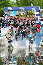 (c) Licenced to London News Pictures 13/06/2015. Windermere, Cumbria, UK. The biggest day at the Great North Swim event in Windermere. The event is various sessions of timed swims in Windermere in a loop route from Low Wood Bay. Saturday has many one mile races, and one half mile race for lower age groups. Photo credit : Harry Atkinson/LNP