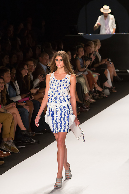 A short white skirt with wedgewod blue print, with a coordinated print sleeveless top.