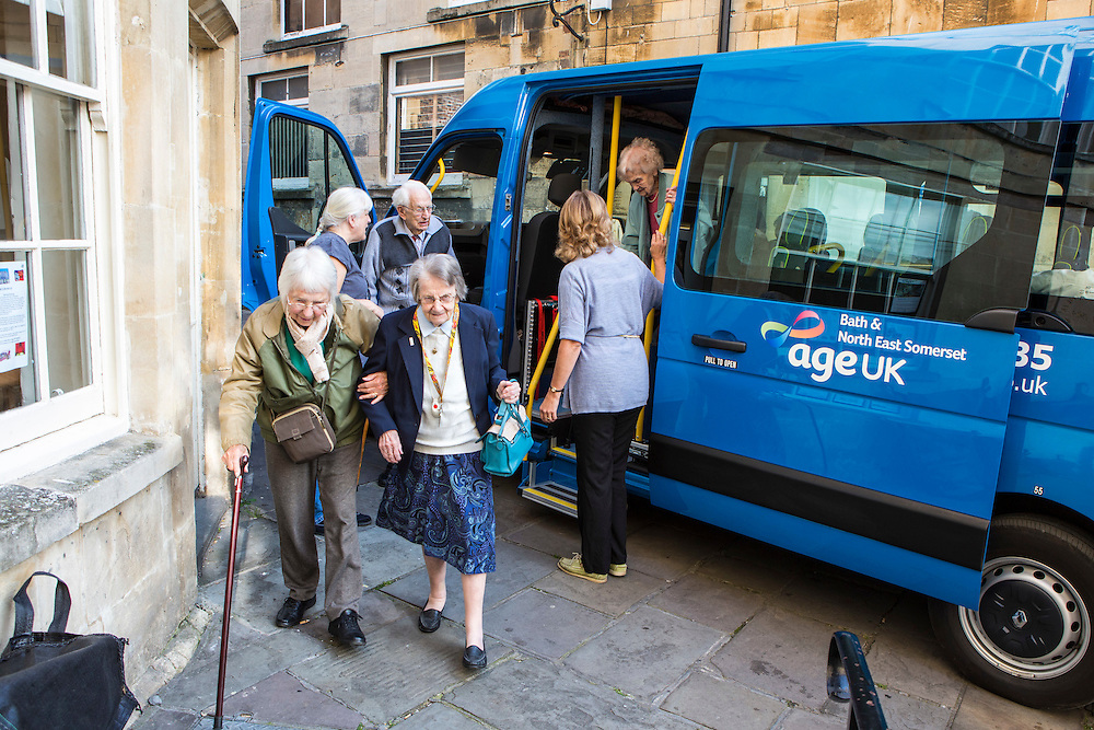 Local elderly residents arrive at an AGE UK day centre in Bath town centre. Bath, Somerset.