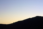 The ridgeline above Queen Charlotte Sound in New Zealand is silhouetted against the late evening sky