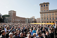 ROME, ITALY - 21 APRIL 2013: Supporters of the Five-Star Movement walk by Piazza Venezia on their way to to the Colosseum for a rally the day after the re-election of President Giorgio Napolitano,  in Rome, Italy, on April 21, 2013.<br /> <br /> Italy's lawmakers re-elected 87-year-old President Giorgio Napolitano on Saturday in a bid to break the country's political gridlock, as protestors outside parliament protested agains the result. Giorgio Napolitano won with a  majority of 738 ballots out of 1,007 possible votes, ahead of leftist academic Stefano Rodota, backed by the the anti-establishment Five Star Movement, who scored 217.