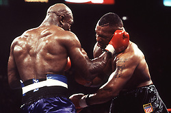 9 Nov 1996:  Mike Tyson, right, is hit by Evander Holyfield, left, during their WBA Heavyweight Championship at the MGM Grand in Las Vegas, NV. Holyfield stopped Tyson in the 11th round to win the match..Mandatory Credit:  Icon Sports Media