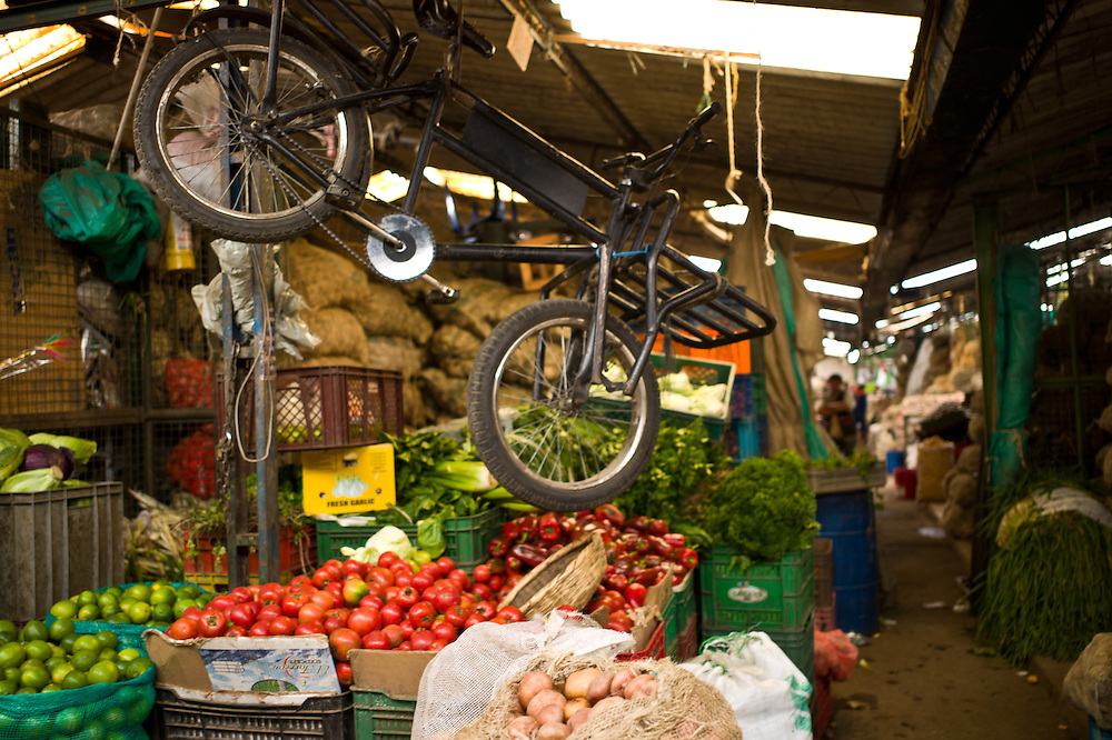Fruits, vegetables, and a flying delivery bike at the Paloquemao Market in Bogotá, Colombia.
