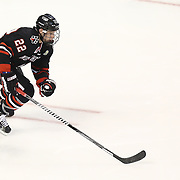 Tanner Pond #22 of the Northeastern Huskies skates on the ice with the puck during The Beanpot Championship Game at TD Garden on February 10, 2014 in Boston, Massachusetts. (Photo by Elan Kawesch)