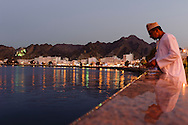 an omani fisherman along the cornice of Mutrah area, Muscat, Oman